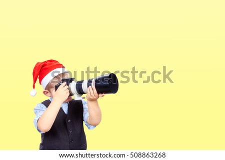 Photographer is taking pictures on a yellow background