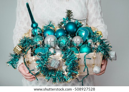Woman hold full wooden box of Christmas tree decoration, ornaments. Christmas or New Year holiday background. #508927528