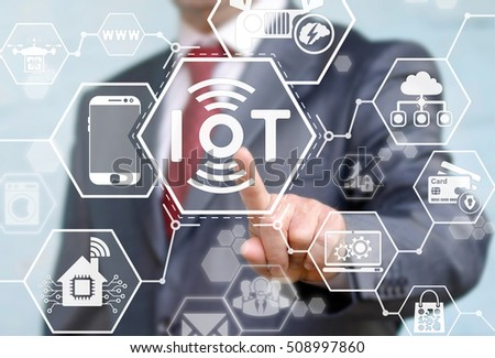 Internet of things (IoT) concept. Businessman presses IoT solution represented by symbol connected with icons of typical IoT. Intelligent house, car, camera, watch, washing machine. Smart digital home #508997860
