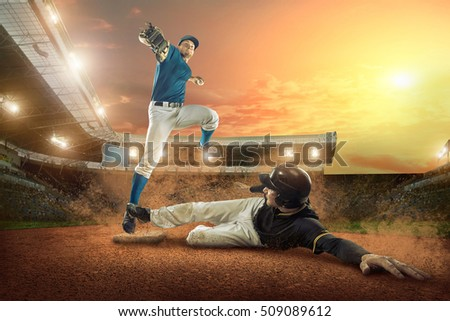 Baseball players in action on the stadium. #509089612