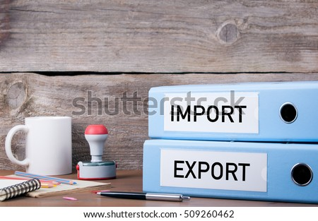 Import and Export. Two binders on desk in the office. Business background Royalty-Free Stock Photo #509260462
