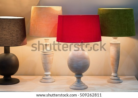 Retro style desk lamps with many lampshade colors decorated in bedroom. #509262811