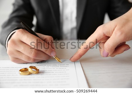 Man signing marriage contract, closeup #509269444
