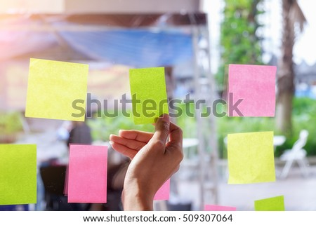 Note paper reminder schedule board. Business people meeting and use post it notes to share idea. Discussing - business, teamwork, brainstorming concept #509307064