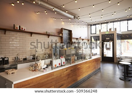 Empty cafe or bar interior, daytime Royalty-Free Stock Photo #509366248