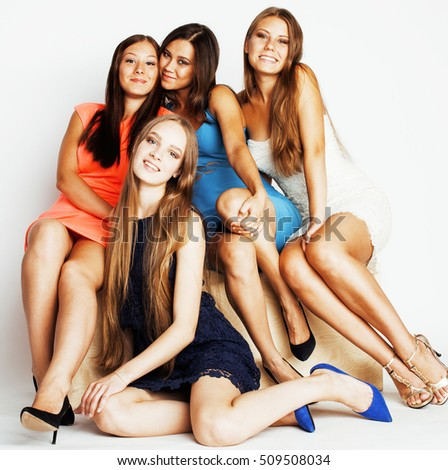group of diverse stylish ladies in bright dresses isolated on white smiling having fun, watching selfie, lifestyle people concept #509508034
