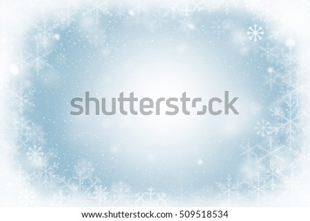 Winter frame of snowflakes with copy space in the center. Christmas background.