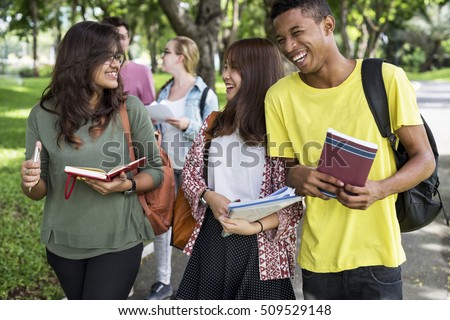Diverse Young Students Book Outdoors Concept #509529148