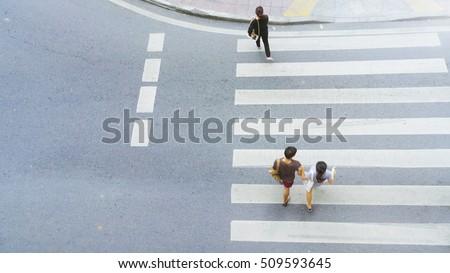 Top view of city people are walking across crosswalk in the city street.  #509593645