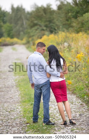 black and white image of a couple looking at each other #509605324