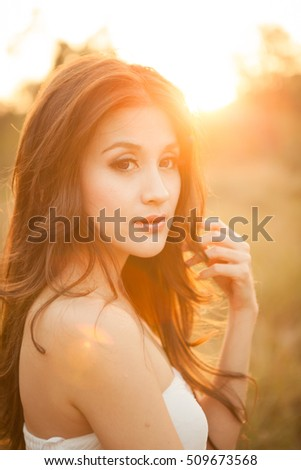 Angel Garden, Beautiful Female Model At Sunset #509673568