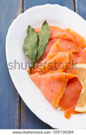 smoked salmon with lemon on white plate #509730289