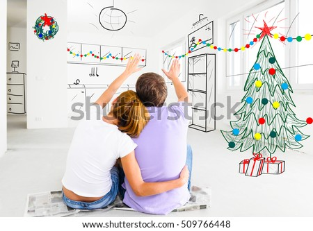 young couple is planning christmas or new year decoration of their new apartments #509766448