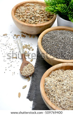 Wooden Bowl full of seeds of chia and fund other healthy seeds #509769400