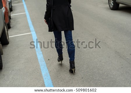 Young woman walking on the city streets #509801602