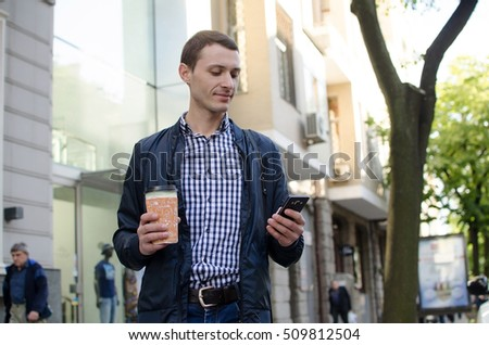 Young man using his phone on the street #509812504