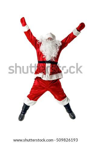 Joyful Santa Claus. Santa Claus jumping, Santa Claus waving his arms. Santa Claus isolated on white. #509826193
