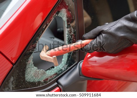 thief hitting the glass of a car to rob #509911684