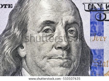 US President Benjamin Franklin portrait on one hundred dollar bill fragment macro #510107635