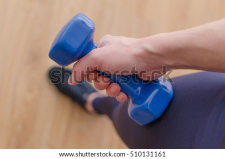 Young woman is making exercises in the hall #510131161