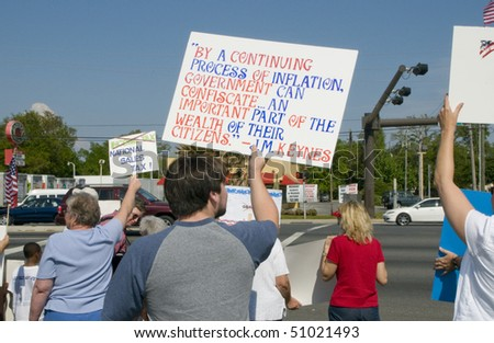 PENSACOLA - APRIL 15:  An estimated 1000 tax day Tea Party protesters peacefully assembled to voice their concern over government spending on April 15, 2010 in Pensacola, Florida. #51021493