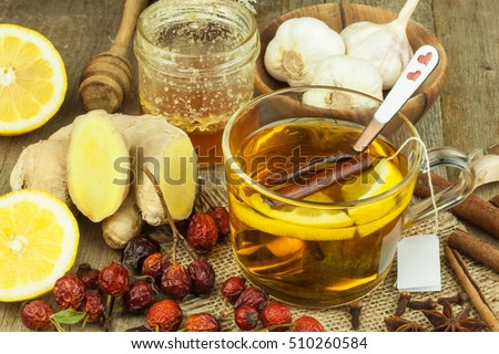 Natural treatment for colds and flu. Ginger lemon honey garlic and rosehip tea against influenza. Hot tea for colds. Home Pharmacy. Proven treatment of diseases. Folk medicine.  Royalty-Free Stock Photo #510260584