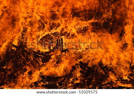 Photo of bright fire flames in darkness #51029575