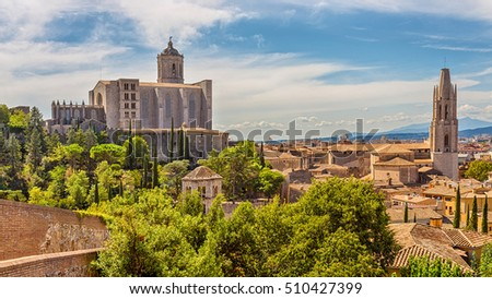 View of the medieval city of Girona with the Cathedral of St. Mary and the Church of St. Feliu. Girona, Catalonia, Spain. #510427399