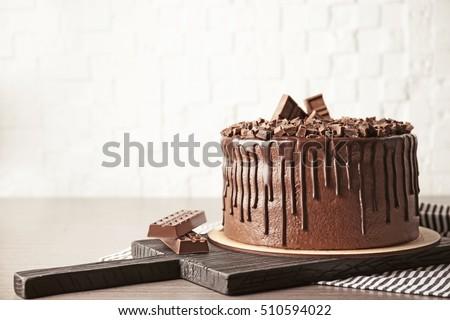 Tasty chocolate cake on brick wall background #510594022