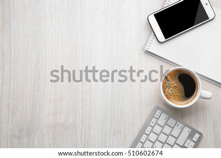 Cup of coffee with office tools on light wooden background #510602674