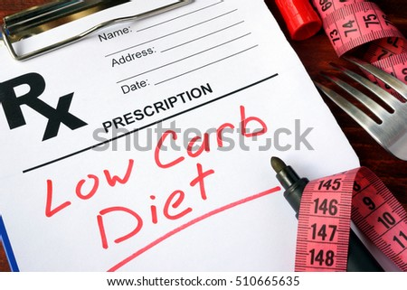 Prescription form with words low carb diet. Royalty-Free Stock Photo #510665635