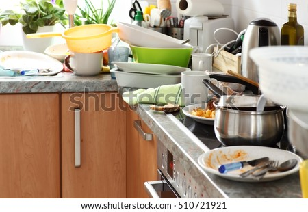 Pile of dirty dishes in the kitchen - Compulsive Hoarding Syndrom Royalty-Free Stock Photo #510721921