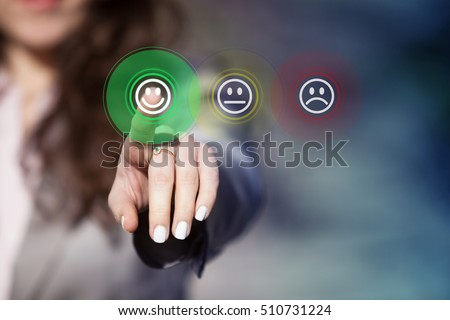 Businesswoman pressing smiley face emoticon on virtual touch screen. Customer service evaluation concept. Royalty-Free Stock Photo #510731224