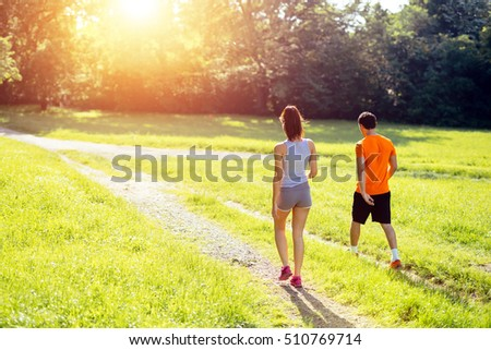 Healthy couple jogging in nature in good spirit #510769714