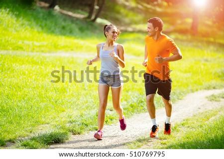 Athletic couple jogging in nature in good spirit #510769795