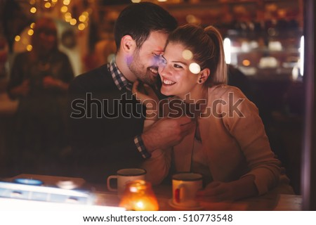 Romantic couple dating at night in pub #510773548