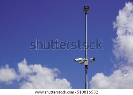 security cctv cameras on a pole with blue sky background #510816532