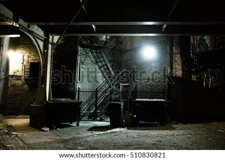Dark Urban Alley at Night Royalty-Free Stock Photo #510830821