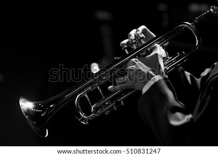 Hands of the musician playing a trumpet closeup in black and white #510831247