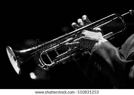 Hands of the musician playing a trumpet closeup in black and white #510831253