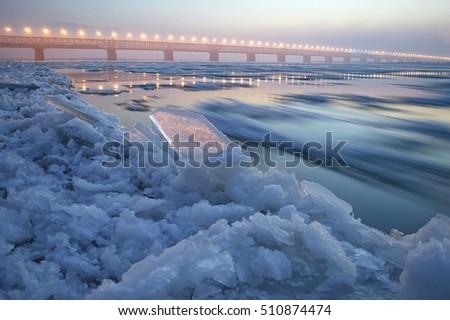 Ice drift on the Amur river. Amur bridge. Trans siberian railway. Khabarovsk, far East, Russia. #510874474