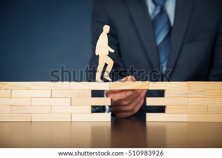 Customer care, support (help) and life insurance concept. Businessman representing company helps (support) customer (client) to overcome an obstacle. Problem solving with smart and simple solutions. Royalty-Free Stock Photo #510983926