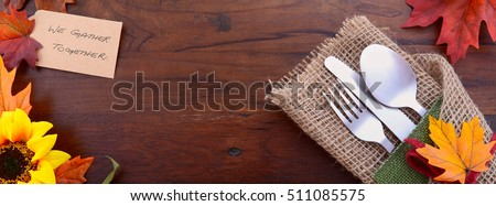 Rustic Thanksgiving dark wood table with place setting, sized to fit a popular social media cover image placeholder.