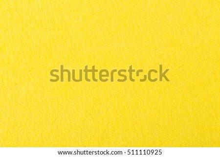 Background of bright yellow felt. High resolution photo. #511110925