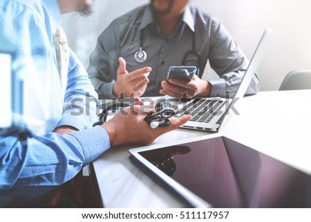 Medical technology network team meeting concept. Doctor hand working smart phone modern digital tablet laptop computer graphics chart interface, sun flare effect photo #511117957