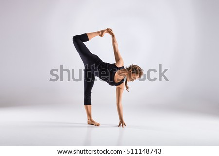 Sporty middle age woman doing yoga practice isolated on white background - concept of healthy life and natural balance between physical and mental evolution #511148743