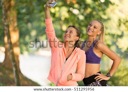 Beautiful girls taking a selfie with a smart phone. #511295956