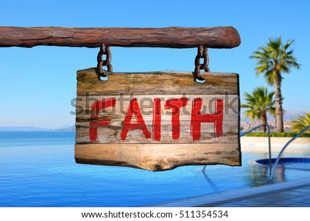 Faith motivational phrase sign on old wood with blurred background #511354534