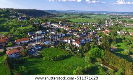 Arial view above a german village green view #511371628