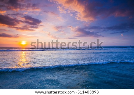 Beautiful view on sea with coming surf waves unsed sunset sky #511403893